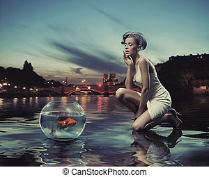 Beauty lady with gold fish
