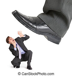 Big foot of crisis crushes small entrepreneur isolated on white