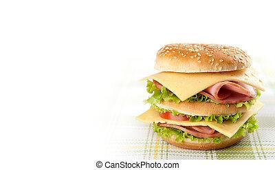 Big sandwich with lettuce, tomato, ham and cheese. Hamburger