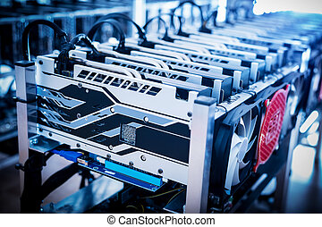 Bitcoin mining devices standing in a row.