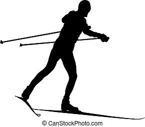 black silhouette male skier