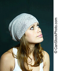 girl in a grey cap with pastes
