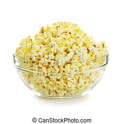 Bowl of fresh popped popcorn isolated on white background