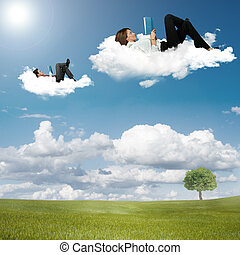 Boy and girl reading book on the clouds