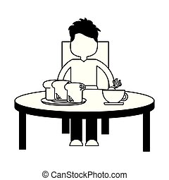 boy eating breakfast in the table