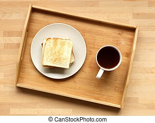 A close up shot of a wooden breakfast tray