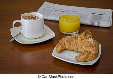 breakfast with coffee, juice and croissant