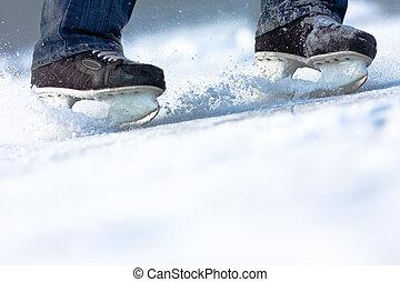 Breaking ice skates, plenty of copy space