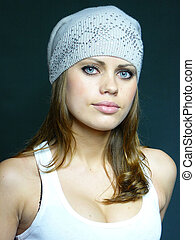 woman in a grey cap with pastes
