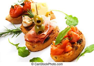 Bruschette with prosciutto and olive