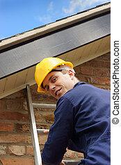 Builder or roofer climbing a ladder