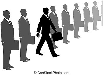 A take charge business man with initiative and a briefcase steps out of a line of gray suits.