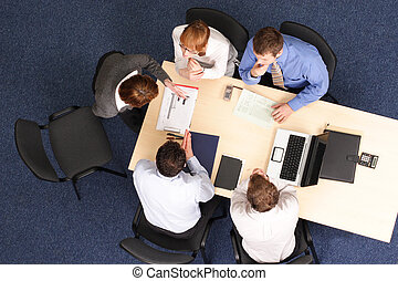 business woman making presentation to group of people