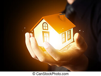 Businessman holding home model