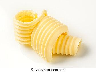 Curls of fresh butter - studio shot