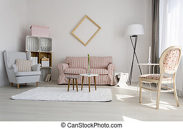 Shot of a cozy living room decorated with pastel colors