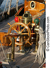 captens position in an antique wooden sailing yacht
