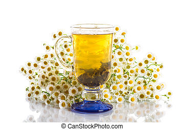 chamomile tea and a bouquet of daisies on a white background