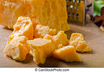 A grouping of crumbled cheddar cheese.