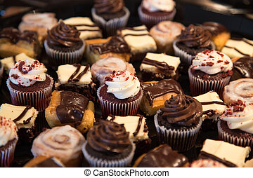 A large tray of chocolate various chocolate pastries and treats ready for the party. Would make a great puzzle.