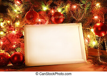 Colorful abstract background with christmas lights and white frame. Christmas background with Ribbon boll and ornaments