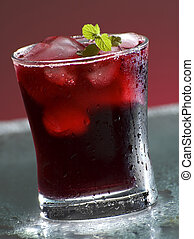 close up of a cold drink with mint on top