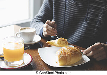 close-up of young man eating breakfast coffee