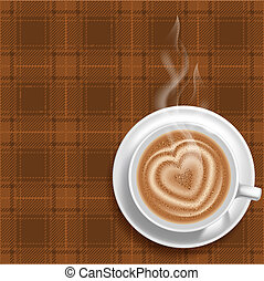 Cup of hot coffee on a table covered by tartan tablecloth