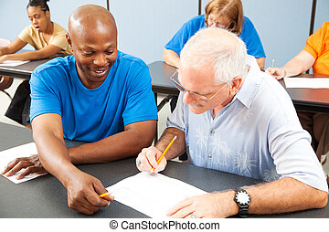 Younger college student tutors mature older student who is struggling to keep up. Focus on the tutor.