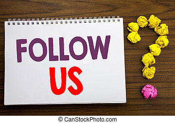 Conceptual hand writing caption inspiration showing Follow Us. Business concept for Social Media Marketing written on notepad note paper on the wooden background with question mark.