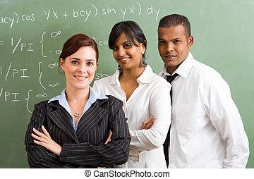 teachers in front of blackboard