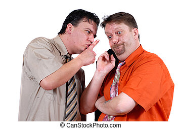 Two men conspiring and gossiping with an amazed and bewildered look, isolated over white. Business and general human relations concept of gossip and curiosity.