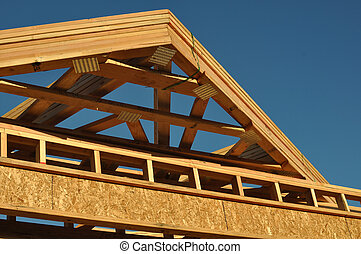 Construction of New Roof on Home with Blue Sky