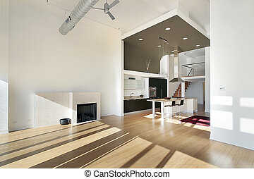 Contemporary kitchen in condominium with view from family room