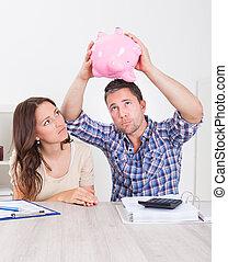 Couple Expecting Money From Piggybank
