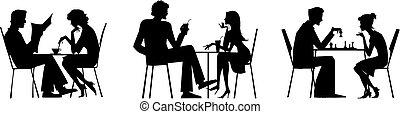 Vector couple silhouettes near table