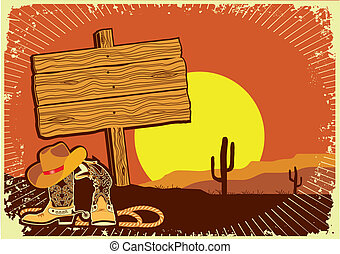 Cowboy's landscape .Grunge wild western background of sunset with boots