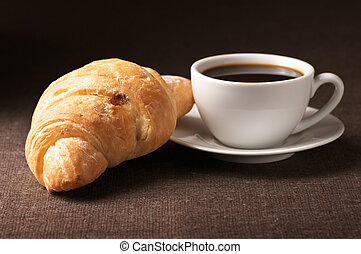 Croissant and black coffee