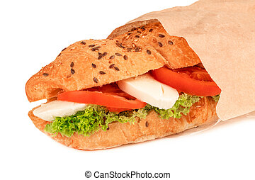 croissant sandwich with mozzarella and tomato isolated on white background