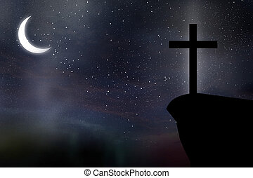 Cross against night sky
