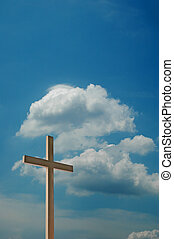 Cross and blue sky with clouds