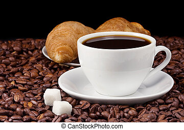 coffee and croissant on beans