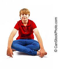 cute boy sitting on the floor