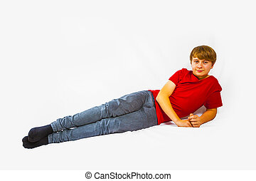 cute handsome boy lying at the floor