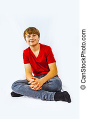 cute handsome boy sitting at the floor