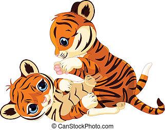 Two cute playful tiger cub