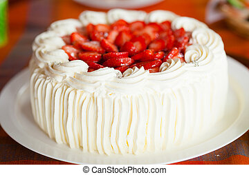 Delicious strawberry cake with strawberries and whipped cream