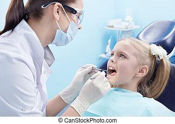 The dentist treats teeth patient