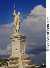 Detail of marble Statue of greek god Poseidon at Havana bay under blue sky