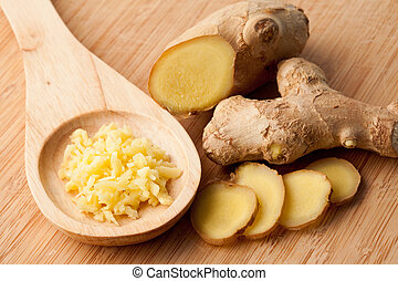 Different forms of ginger against a wood worktop